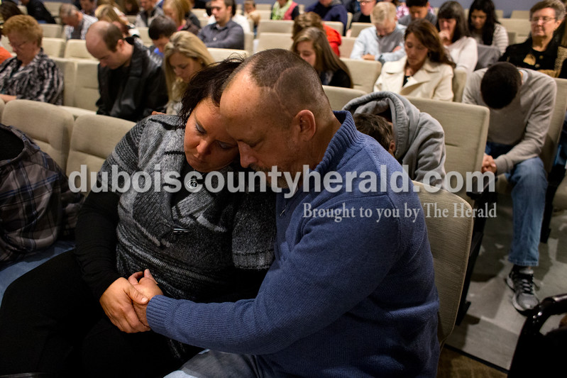 Alicia Roach, left, and her fiancé, Tim Bolton, both of Jasper, prayed together during the Christian Church of Jasper's Sunday service in the church's new worship center. Dave Weatherwax/The Herald