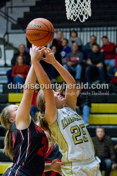 Southridge's Kendyl McKeough shot while Jasper's Kirby Ruhe defended during the game against Saturday in Jasper. The Raiders beat the Wildcats 49-47.<br /> Caitlin O'Hara/The Herald