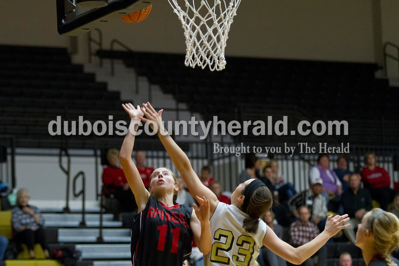Southridge's Aubrey Main shot past Jasper's Reagan Hochmeister during the game against Saturday in Jasper. The Raiders beat the Wildcats 49-47.<br /> Caitlin O'Hara/The Herald