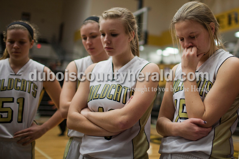 Caitlin O'Hara/The Herald<br /> From left, Jasper's Maria Gobert, Alex Krapf, Regan Hedinger and Anna Mundy paused for a time out in the game against North Harrison on Tuesday in Jasper. The Wildcats lost 46-36.