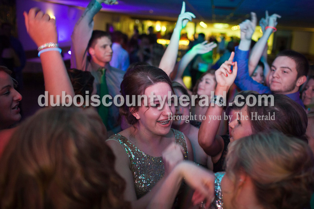 """Northeast Dubois High School junior Liv Huebner danced to Taylor Swift's """"Shake it Off"""" with friends at the school's winter ball at Celestine Community Club.<br /> Caitlin O'Hara/The Herald"""