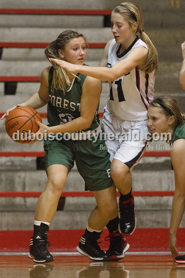 Forest Park's Mariah Morgan, left, looked for an open pass to teammate Tylor Hopf while being guarded by Southridge's Aubrey Main during Tuesday night's game at Memorial Gym in Huntingburg. Rachel Mummey/The Herald