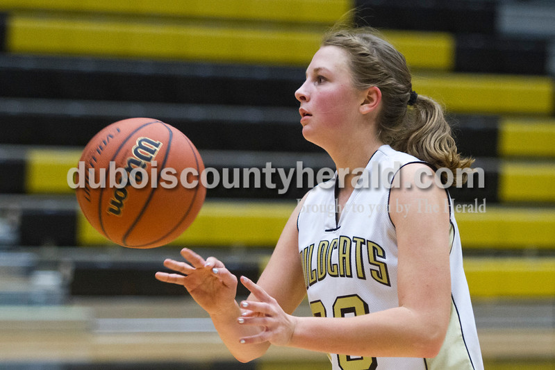 Caitlin O'Hara/The Herald<br /> Jasper's Katelyn Hedinger passed during the game against North Harrison on Tuesday in Jasper. The Wildcats lost 46-36.