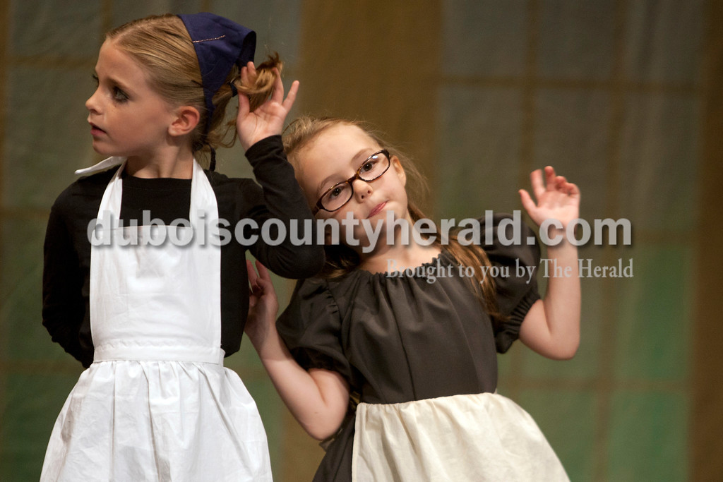 """AzLeigh Barker, 8, left and Zoie Warner, 6, both of Jasper, dressed as """"counts people"""" during The Children's Theatre Project  dress rehearsal of Disney's Beauty and the Beast Jr. at Jasper Middle School in Jasper. Heather Rousseau/The Herald"""
