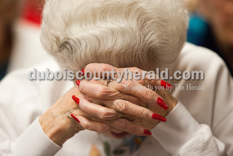 Northwood Retirement Community resident Gertrude Major bowed her head in prayer during the Veterans Day service in Jasper. Rachel Mummey/The Herald