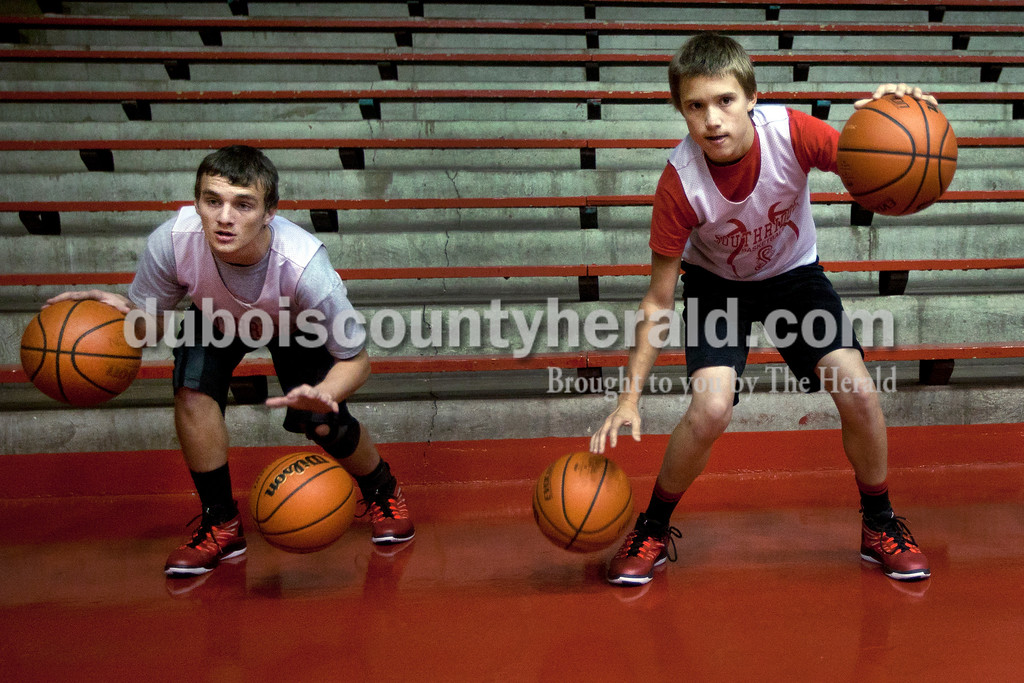 Southridge High School sophomores Jeremy Deel, left, and Braden Harding dribbled two basketball each during Raider boys basketball practice at Huntingburg Memorial Gym. Southridge will open their season Saturday, Dec. 6, at Corydon Central.<br /> Heather RousseauThe Herald