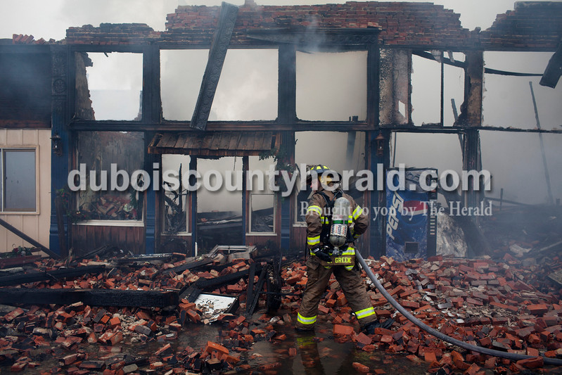 Multiple fire departments respond to a fire affecting five local businesses on Wednesday, Nov. 12, 2014 in downtown Loogootee, Ind. A 911 call reporting the fire was received at 10 a.m.<br /> The Herald/Caitlin O'Hara