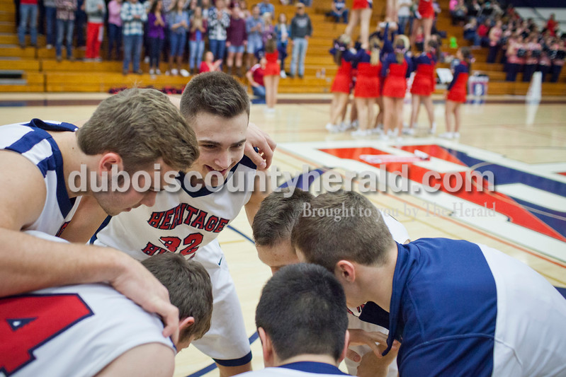 Heritage Hills' Gavin Schaefer led a pep talk before the Patriots played the Northeast Dubois Jeeps on Saturday in Lincoln City. The Patriots won 66-52.<br /> Caitlin O'Hara/The Herald