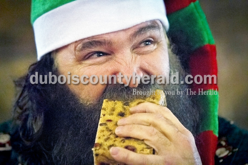 Former professional wrestler Mick Foley competed in the 2014 International Fruitcake Eating Championship on Saturday in Santa Claus. He placed fourth after appearing to finish second, because he left some fruitcake uneaten under his chair. His participation in the 2013 contest was also controversial, when he transferred his fruitcake onto a fellow competitor's plate.<br /> Caitlin O'Hara/The Herald