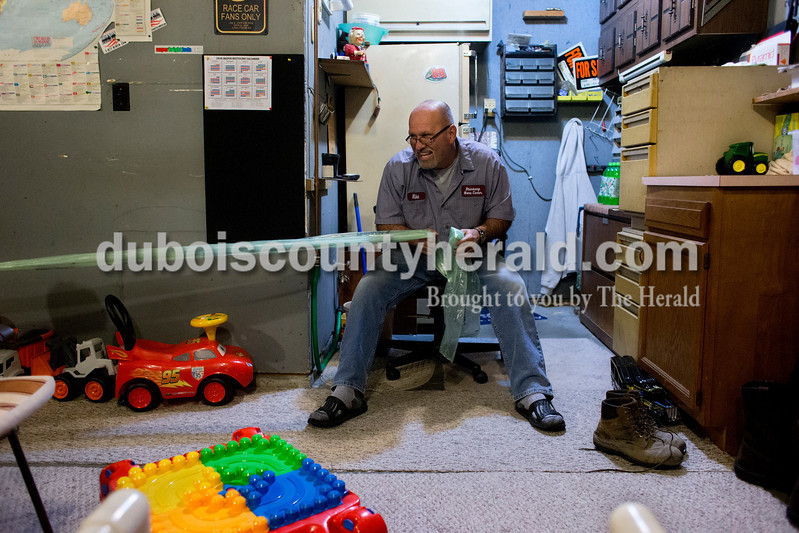 "During the past 11 months, what was previously Mike's ""man cave"" in his garage was transformed into a play area. Mike played with Carson in the garage the evening of Nov. 18 as Sherri prepared dinner. Dave Weatherwax/The Herald"