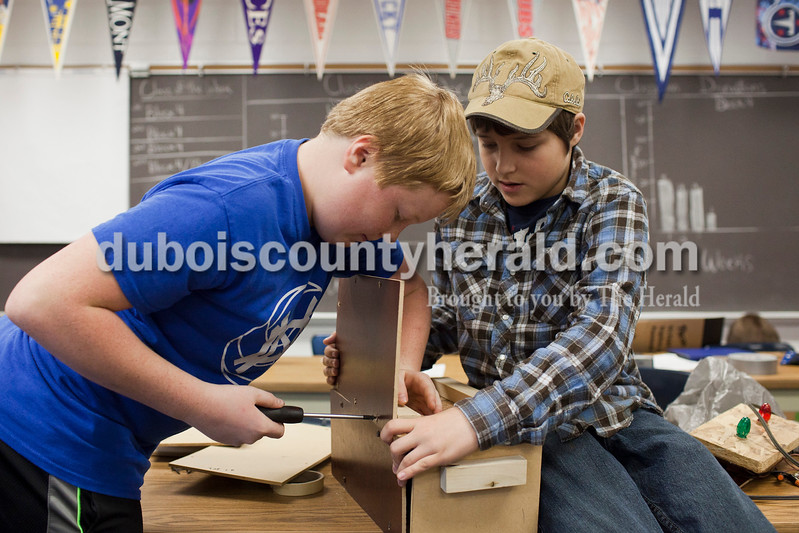 Caitlin O'Hara/The Herald<br /> Sixth-graders Parker Beckman, left, and Beau Linne, right, assembled their mailbox alarm for the Shark Tank competition Wednesday at Dubois Middle School. The device lights up a bulb in your home to let you know when you have mail or the newspaper.