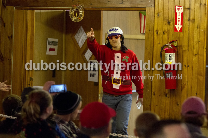 Herald Sports Writer Joe Jasinski made his entrance during introductions of the 2014 International Fruitcake Eating Championship on Saturday in Santa Claus.Caitlin O'Hara/The Herald