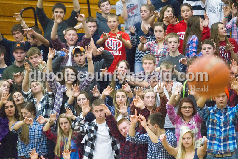 Heritage Hills students silently willed a free throw into the basket with spirit fingers during the game against Northeast Dubois on Saturday in Lincoln City. The Patriots won 66-52.<br /> Caitlin O'Hara/The Herald