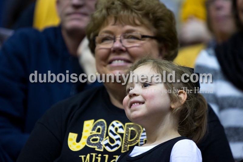 Ava Ballard of Jasper, 3, sat with her grandmother, Judy Yarbrough of Jasper, during Saturday night's Class 3A sectional against Vincennes Lincoln at Washington. Jasper lost to Vincennes Lincoln 69-54.<br /> Alisha Jucevic/The Herald