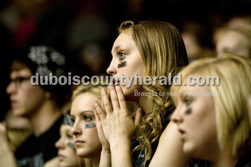 Forest Park senior Taylor Hopf nervously watched the fourth quarter of Saturday night's Class 2A sectional championship against Mater Dei at Memorial Gym in Huntingburg. The Rangers lost 69-64. Ariana van den Akker/The Herald