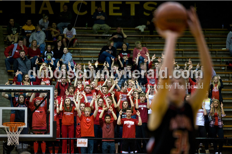 Southridge fans put their hands in the air as Cam O'Bryan shot a free throw during Saturday night's Class 3A sectional against Washington at Washington. Southridge lost to Washington 49-43.<br /> Alisha Jucevic/The Herald