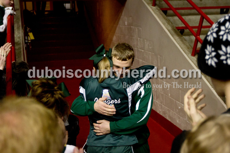 Forest Park senior Kayla Knust hugged Austin Bromm after Saturday night's Class 2A sectional championship against Mater Dei at Memorial Gym in Huntingburg. The Rangers lost 69-64. Ariana van den Akker/The Herald