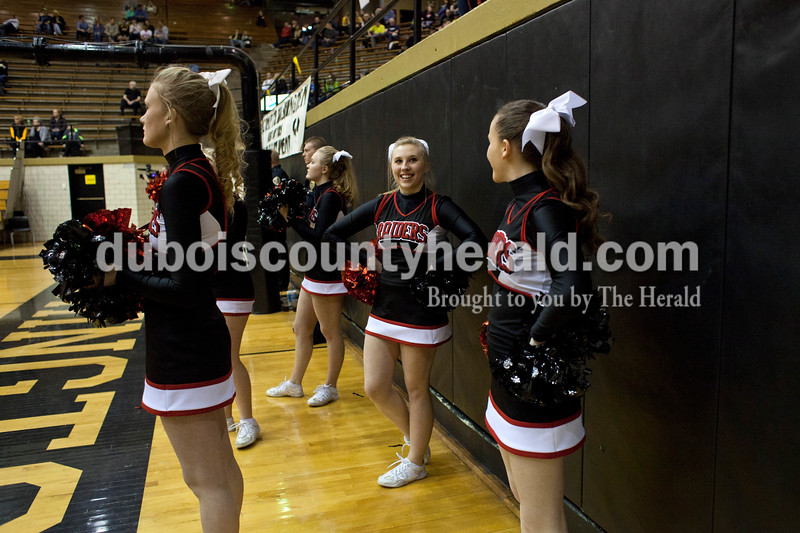 Southridge cheerleader Haley Barnett, center, smiled and looked up at the fans during Saturday night's Class 3A sectional against Washington at Washington. Southridge lost to Washington 49-43.<br /> Alisha Jucevic/The Herald