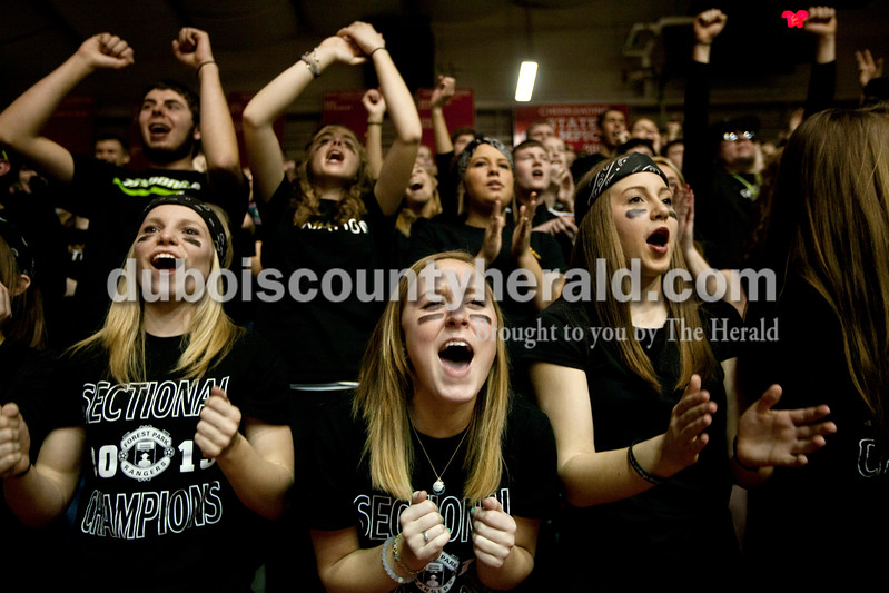 Forest Park seniors Kayla Hoffman, left, Hailei Gehlhausen and Taylor Prechtel cheered for the team during Saturday night's Class 2A sectional championship against Mater Dei at Memorial Gym in Huntingburg. The Rangers lost 69-64. Ariana van den Akker/The Herald