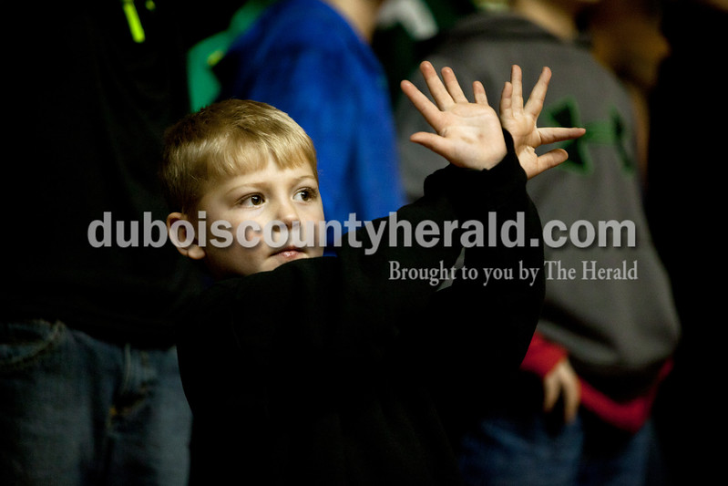 Carter Jochem of St. Anthony, 6, held his hands up during free throws at Saturday night's Class 2A sectional championship against Mater Dei at Memorial Gym in Huntingburg. The Rangers lost 69-64. Ariana van den Akker/The Herald