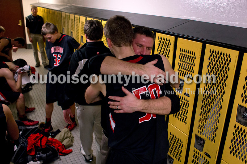 Southridge coach Ted O'Brien hugged Henry Steckler after Southridge's loss to Washington in Saturday night's Class 3A sectional at Washington. Southridge lost 49-43.<br /> Alisha Jucevic/The Herald