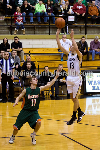 Jasper's Tyler Begle went up for a shot during Saturday night's Class 3A sectional against Vincennes Lincoln at Washington. Jasper lost to Vincennes Lincoln 69-54.<br /> Alisha Jucevic/The Herald
