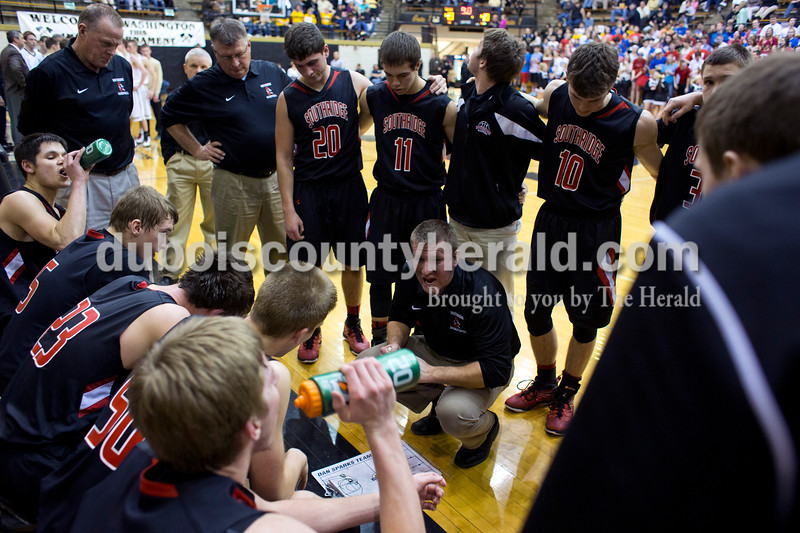 Southridge coach Ted O'Brien talked with his team during the second half of Saturday night's Class 3A sectional against Washington at Washington. Southridge lost to Washington 49-43.<br /> Alisha Jucevic/The Herald