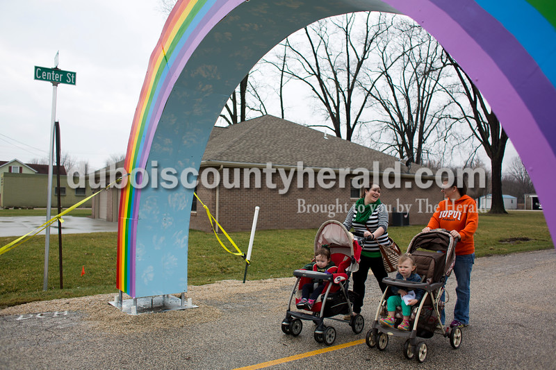 Jessica Miller of Ireland, left, pushed her daughter Tenley, 2, with her sister-in-law Krista Miller and Krista's daughter Kaitlin, 2, under the rainbow arch at the St. Patrick's Celebration on Saturday in Ireland. Alisha Jucevic/The Herald
