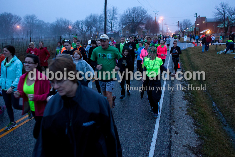 The runners took off from Ireland Elementary School at 8:00 a.m. on Saturday for the Irish Trot 5K run in Ireland. The rain and fog didn't stop the runners. Around 240 people participated in the event.  Alisha Jucevic/The Herald