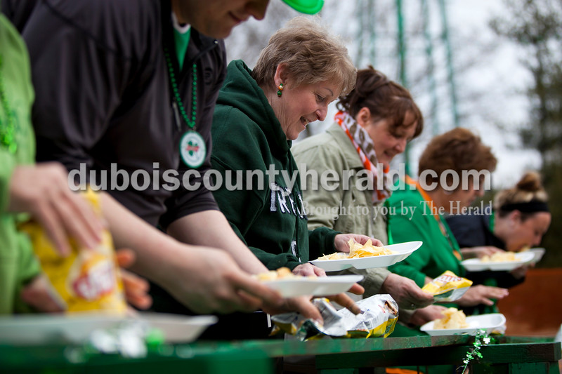 The potato chip eating contestants lined up together at the beginning of the contest during the St. Patrick's Celebration on Saturday in Ireland.  Alisha Jucevic/The Herald