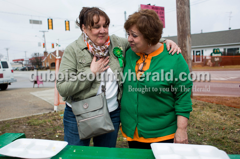 """Connie Nigg of Jasper, left, and Deb Boyles of Ireland rested after the potato chip eating contest on Saturday in Ireland. """"The problem is trying to get it down,"""" said Boyles. """"It just kind of gets stuck.""""  Alisha Jucevic/The Herald"""
