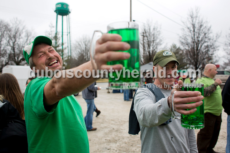 Randy Otto of Celestine, left, and John Truesdale of Duff held up their mugs during the Toast to the O'Blarney Drop mug holding contest on Saturday in Ireland. Truesdale won the round with a final time of 5:44. Alisha Jucevic/The Herald