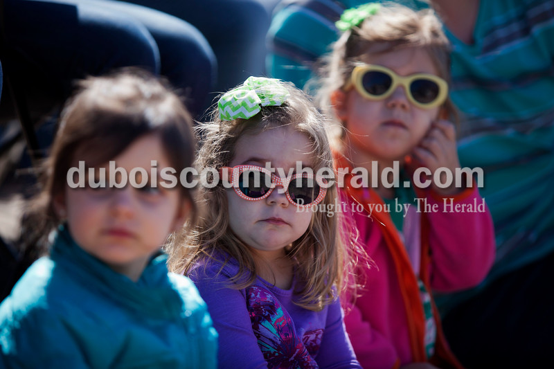 Mia Brown, 2, Presley Vogler, 2, and Sloan Vogler, 4, all of Jasper watched the St. Patrick's Celebration parade on Sunday afternoon in Ireland. Alisha Jucevic/The Herald