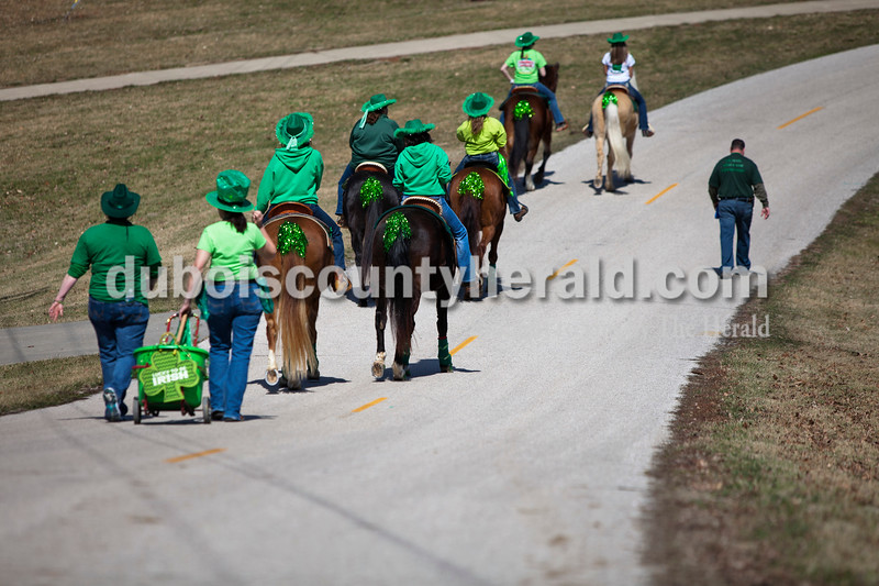 Members of the Ireland Bicentennial float walked toward the church parking lot after the St. Patrick's Celebration parade on Sunday afternoon in Ireland. Alisha Jucevic/The Herald