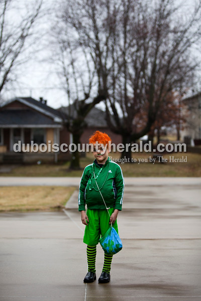 """Noah Pieper of Ireland, 10,  during the St. Patrick's Celebration festivities on Saturday in Ireland. Noah said he was dressed like a """"mean and green"""" leprechaun.  Alisha Jucevic/The Herald"""