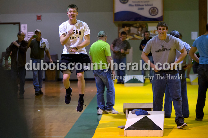 Cal Krueger of Ireland, 17, jumped in the air after scoring a point during the cornhole tournament  Friday night at the Ireland Elementary School gymnasium. Alisha Jucevic/The Herald