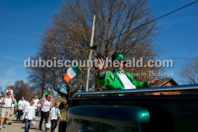Honorary Mayor for the Day Allen Brescher of Ireland waved to the  spectators during the St. Patrick's Celebration parade on Sunday afternoon in Ireland. Alisha Jucevic/The Herald