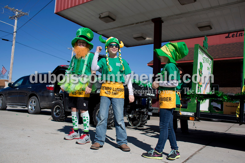 Ian Giesler, 11, Anden Rohleder, 9, and Keira Giesler, 7, all of Jasper, motioned for cars to honk their horns as they waited for the St. Patrick's Celebration Parade to begin on Sunday afternoon in Ireland. Alisha Jucevic/The Herald