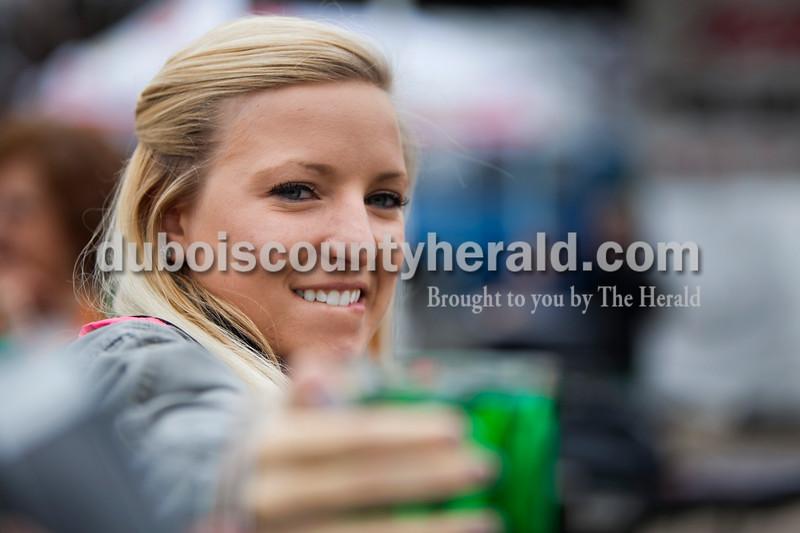 Tara Brescher of Ireland, 21, held up a mug during the Toast to the O'Blarney Drop mug holding contest on Saturday in Ireland. Alisha Jucevic/The Herald
