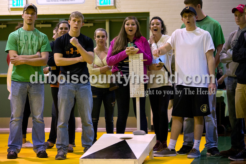 A group of friends gathered to watch the second to last round of the teenage division of the cornhole tournament on Friday night at the Ireland Elementary School gymnasium. Alisha Jucevic/The Herald