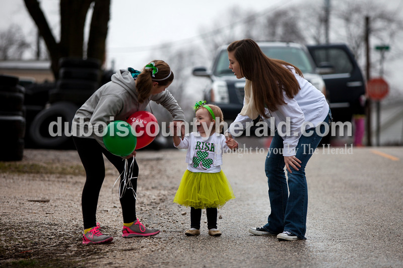 Layn Wehr of Ireland, 2, center, held hands with Kaitlynn Mendel of Ireland, 11, left, and Molly Schwenk of Jasper, 17, during the St. Patrick's Celebration on Saturday in Ireland. Alisha Jucevic/The Herald