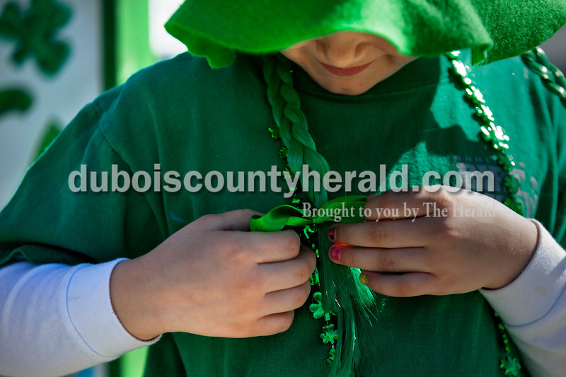 Keira Giesler of Ireland, 7, fixed the bow on her green braid before the St. Patrick's Celebration parade on Sunday afternoon in Ireland. Alisha Jucevic/The Herald