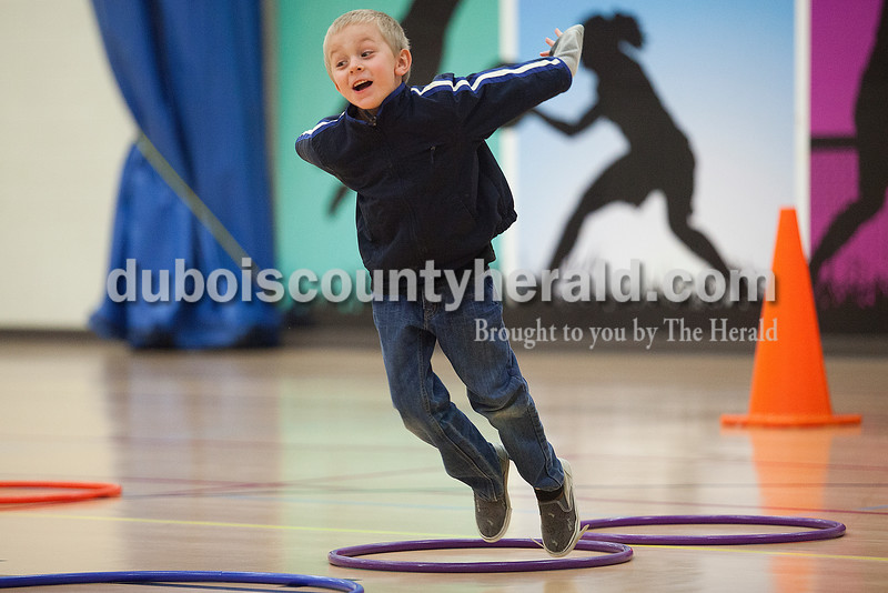 Kayden Kersteins of Ferdinand, 5, leapt through hula-hoops during a relay race at the YMCA in Ferdinand on Tuesday. With school out of session for spring break, the center is offering day camp for area children. Rachel Mummey/The Herald
