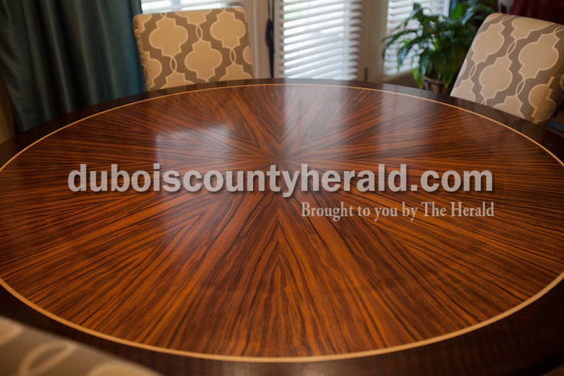 A custom made table created by Hubbs sits in the dining room of in his Ferdinand home.