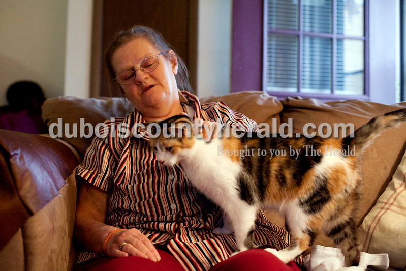 Ariana van den Akker/The Herald<br /> Katie Buhr of Huntingburg petted her cat Princess at her home on Thursday. Buhr is in the final stages of renal failure and has diabetes and congestive heart failure. She needs a kidney transplant but says that she lacks a support system. On Thursday evening, Buhr was waiting for paperwork to go through so she could move to the Waters in Huntingburg.