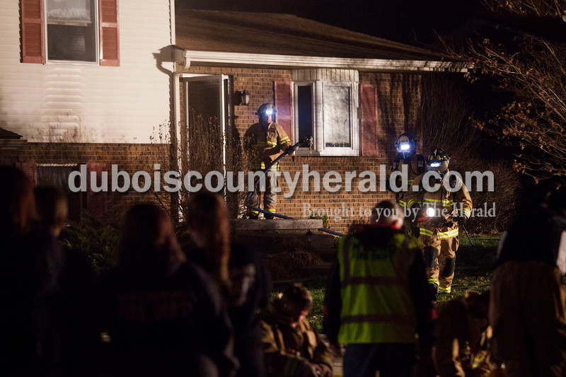 Alisha Jucevic/The Herald  <br /> <br /> Firefighters worked to put out a house fire on Wednesday night at 102 East 22nd Street in Huntingburg. The fire was reported around 8:40 p.m. and took about an hour to put out. First assistant chief Glen Kissling said the fire originated in the laundry room and caused major damage throughout the house. Co-owner and the resident of the home, James Gatwood, was not home when the fire began and no one was injured at the scene.