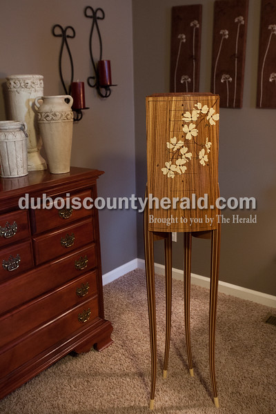 Richard Hubbs designed and built this unique jewelry armoire that sits in his Ferdinand home. It is made from over 400 pieces of wood and has a secret compartment.