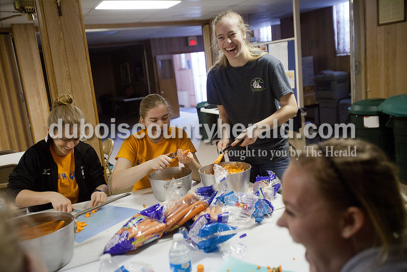 Miranda Sermersheim of St. Anthony, 16, left, Emma Hurst of St. Anthony, 18, her sister Katherin, 16, and Madelyn Pund of Bretzville, 15, chopped carrots for mock turtle soup at Sacred Heart of Jesus Catholic Church in Schnellville on Sunday. The youth group, along with St. Anthony of Padua, made over 120 gallons of soup to raise funds for their organization. It is the third year the group has held the fundraiser. Rachel Mummey/The Herald