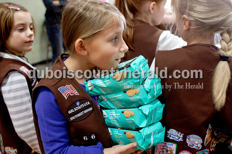 Avery Fuhs of Jasper, 8, organized cookies on Saturday afternoon at the National Guard Armory in Jasper.