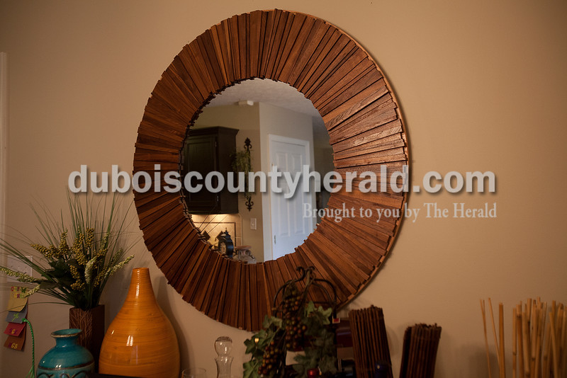 A custom made mirror created by Hubbs hangs on the wall in the dining room of in his Ferdinand home.